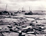 26. ID ASH096 The severe winter 1962-63 at West Mersea Hard looking out towards the Packing Shed and the river. Wherever possible boats were brought ashore and any wooden ...
